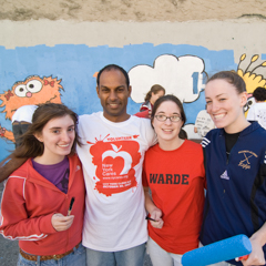 Group of Students in Front of Mural